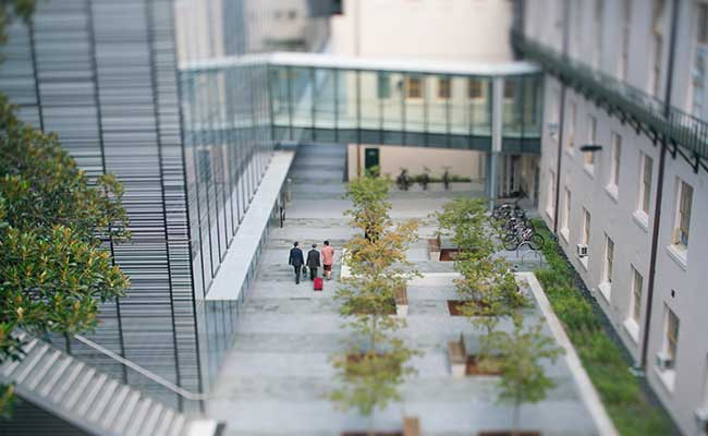 Image: Aerial shot of three figures walking next to the Sydney Nanoscience Hub